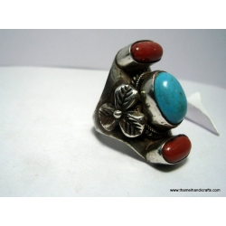 torquise coral ring with lower carving